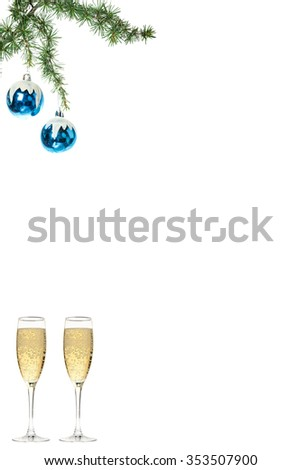Christmas decoration with green pine and blue snow roud ball ornaments with two glasses of champagne. Holiday decorations isolated on white background. Empty or copy space for holiday greeting card - stock photo