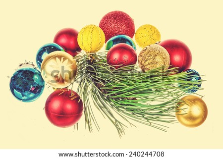Christmas decoration with green pine or fir and many gifts for Christmas tree. Holiday decorations isolated on yellow background, vintage retro effect - stock photo