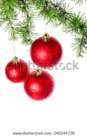 Christmas decoration with green pine or fir and red round ball ornaments for Christmas tree. Holiday decorations isolated on white background. Empty or copy space for holiday greeting card - stock photo