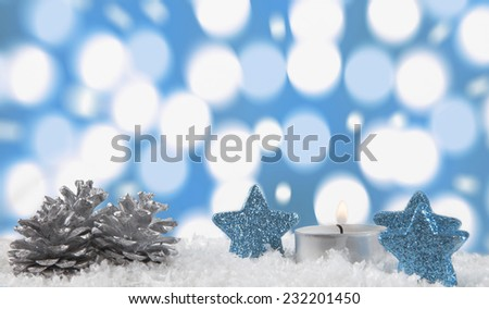 Christmas decoration with light bokeh in the background.jingle bells  laying arround . Blue background. - stock photo