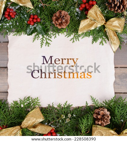Christmas decoration with paper sheet on wooden background - stock photo
