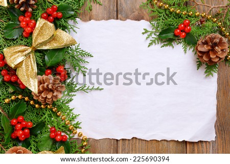 Christmas decoration with paper shit on wooden background - stock photo