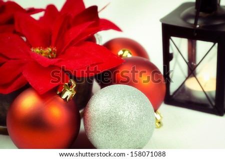 Christmas decoration with poinsettia and candle - stock photo