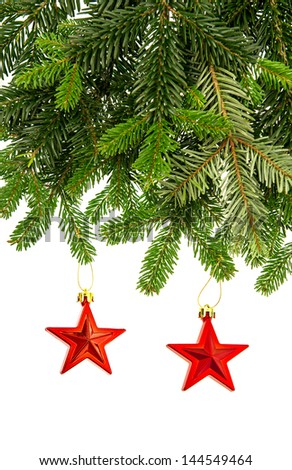 christmas decoration with red stars and fir tree branch on white background - stock photo