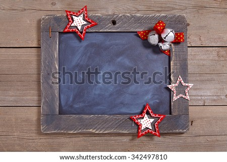 Christmas decoration with rustic chalkboard and stars - stock photo