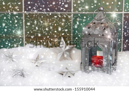 Christmas decoration with silver metal lantern on window sill