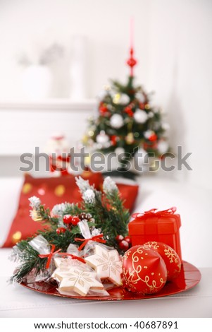 Christmas decoration with small gingerbread and tree at home - stock photo