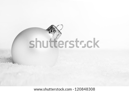 Christmas decoration with snow on white background - stock photo