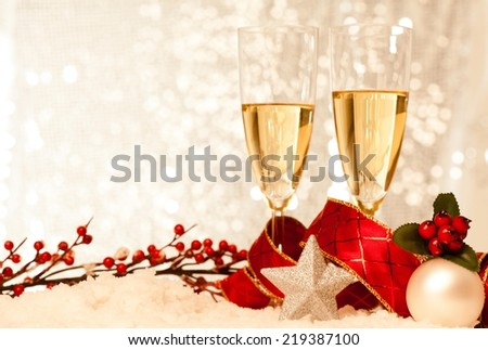 Christmas decoration with two champagne glasses against beautiful background. Useful as a christmas card. - stock photo