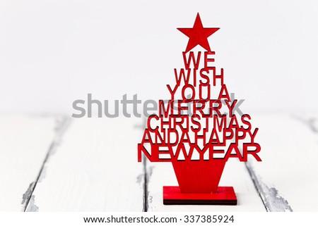 christmas decoration with wishful greeting - stock photo