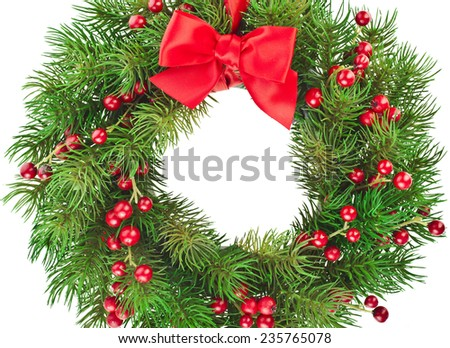 Christmas decoration wreath with red holly berries close up isolated on white background - stock photo