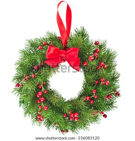Christmas decoration wreath with red ribbon bow isolated on white background - stock photo