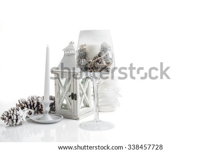 Christmas decorations and candle isolated on white background - stock photo