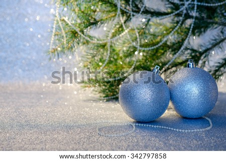 Christmas decorations and christmas fir tree branch. Selective focus. Space for text.