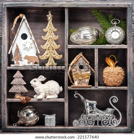 Christmas decorations and Christmas toys in wooden box. - stock photo