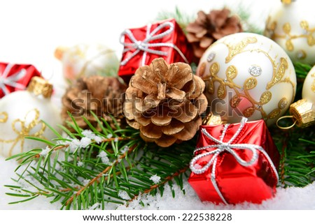 Christmas decorations and Christmas tree in the snow on a white background, greeting card - stock photo