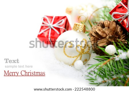 Christmas decorations and Christmas tree in the snow on a white background, greeting card