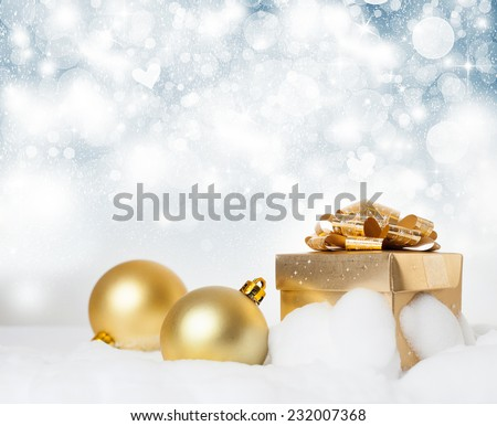 Christmas decorations and gift box on sparkling background - stock photo