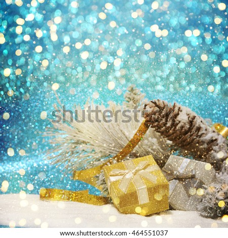 Christmas decorations and gift box on sparkling background