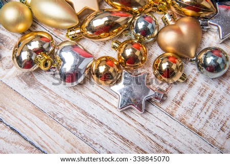 Christmas decorations and gift boxes on wooden board background - stock photo
