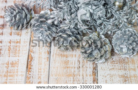 Christmas decorations and gift boxes on wooden board background (Selective Focus) - stock photo