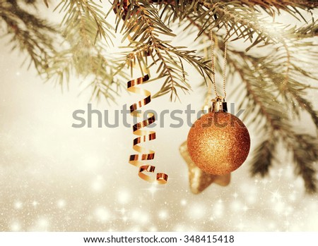 Christmas decorations and gift boxin front of snow cowered pine trees  - stock photo
