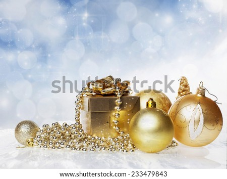 Christmas decorations and golden gift box on sparkling background - copy space