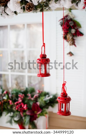 Christmas decorations and lanterns outside house - stock photo
