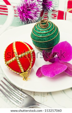 Christmas decorations and Orchid on the kitchen table