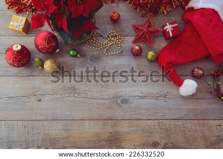 Christmas decorations and ornament on wooden background. View from above with copy space - stock photo