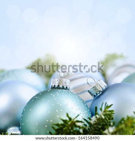 Christmas decorations and ornaments with blue background copy space - stock photo