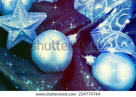 Christmas decorations and ribbon on a blue background - stock photo
