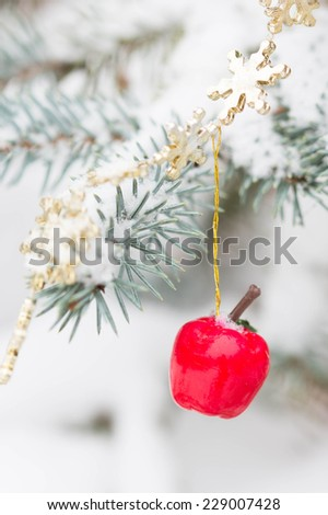 Christmas decorations and snowy blue spruce - stock photo