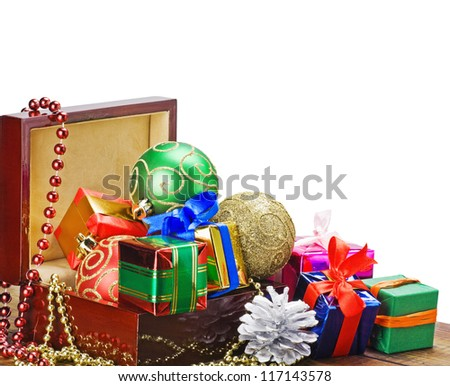 Christmas decorations, balloons and gifts in a wooden box - stock photo