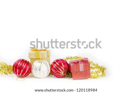 Christmas decorations, balls and gifts on white background