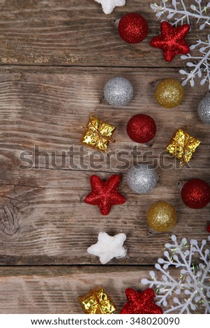Christmas decorations.  Balls, gifts and snowflakes on an old wooden table - stock photo