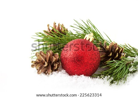 Christmas decorations - balls, pine cones and green branch on white background - stock photo