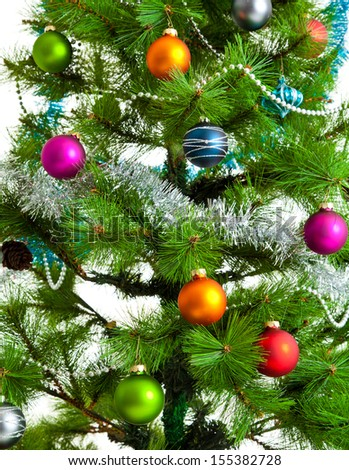 christmas decorations. Christmas ball and green spruce branch - stock photo