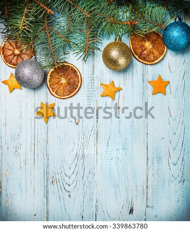 Christmas decorations. dried oranges and nuts on the table - stock photo