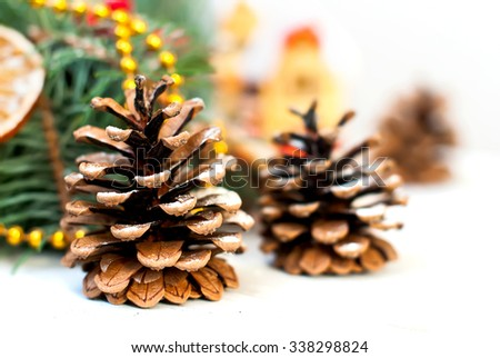 Christmas Decorations, fir cones and toys�  on the background of fir branches Christmas toned photo selective focus