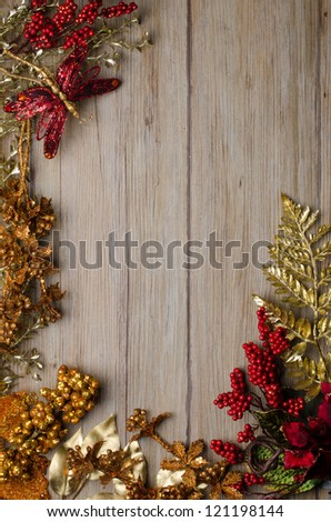 Christmas decorations frame on a wooden board. - stock photo