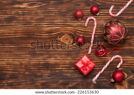 Christmas Decorations. Gift Box. Candy Canes. Wooden Background. - stock photo