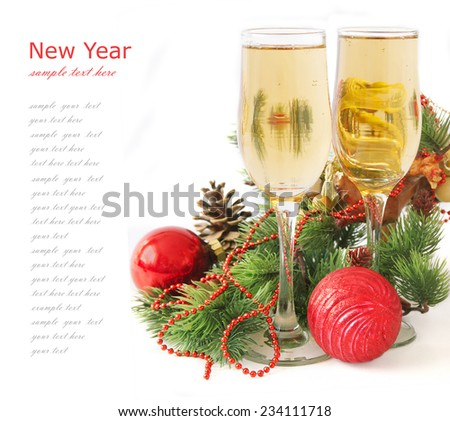 Christmas decorations, glasses of champagne and new year tree isolated on white background with sample text - stock photo