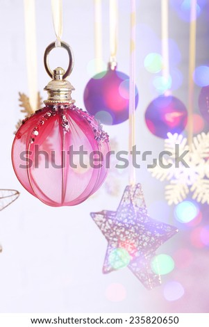 Christmas decorations hanging on festive background - stock photo
