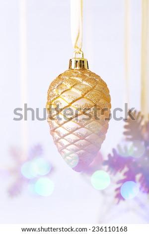 Christmas decorations hanging on festive background - stock photo