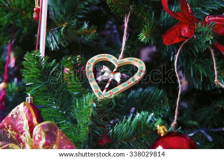 Christmas decorations hanging on pine branches - stock photo