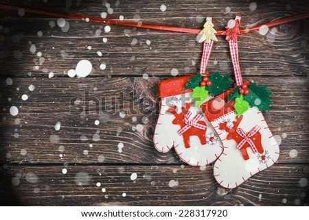 Christmas decorations hanging on the wooden background - stock photo