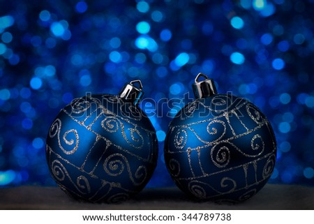 christmas decorations in blue tones - defocused light in  background - stock photo
