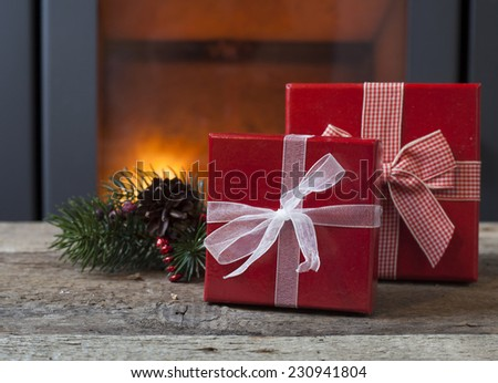 Christmas decorations in front of a fireplace - stock photo