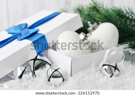 Christmas decorations in gift box with fir tree closeup - stock photo